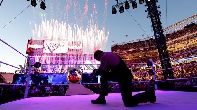 Undertaker celebrating his win against Bray Wyatt. Photo courtesy of WWE.